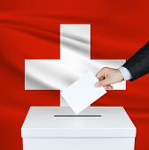Election In Switzerland. The Hand Of Man Putting His Vote In The Ballot Box. Waved Switzerland Flag  poster