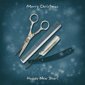 Hairdressing Scissors, Comb And Razor On A Dark Background. Happy New Year And Merry Christmas. Gree poster