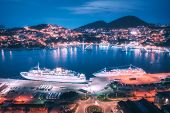 Aerial View Of Cruise Ship In Port At Night. Landscape With Ships And Boats In Harbour, City Lights, poster