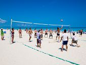 VARADERO,CUBA-MAY 27:Young tourists playing volleyball May 27,2012 in Varadero.With over a million visitors per year,Varadero is the main destination for the growing cuban tourism industry