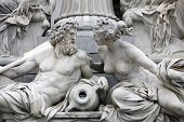 Detail of Pallas-Athene fountain in front of Austrian parliament, Vienna, Austria. Sculptures represent rivers Danube and Inn