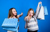 Shopping Day Happiness. Happy Children In Shop With Bags. Sisters Shopping Together. Buy Clothes. Fa poster