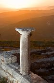 sunset on a column of Episcopal Complex in ancient city of Byllis, Albania