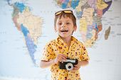 One Little Adorable Kid With Vintage Camera Laughing Happy On World Map Wall Background poster