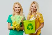 Ecology Concept. Young Women In Casual Clothes Are Holding Ecological Recycled Grocery Bags On Their poster