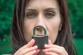 Conceptual Portrait Of A Woman Keeping Silence With Lock Over Her Mouth. Caucasian Woman Keep Mouth  poster