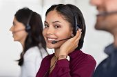 Smiling beautiful woman working in call center as telemarketing operator. Customer support agent wea poster