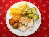 A typical English Christmas dinner of turkey, boiled swede, Brussels sprouts, roasted and mashed pot
