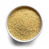 Cous cous in a small white bowl, isolated on white with shadow.  Overhead view.
