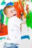 A Child Painting A Wall And Having Fun