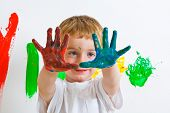 Three Year Old With Painted Hands