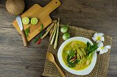 Fish Ball Green Curry With Coconut Curry (kaeng Kheiyw Hwan) On Dark Wooden Background With Thai Tra poster