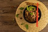 Hot And Spicy Nam Tok Noodles Soup With Meat Balls.thai Boat Noodles Is Street Food Of Thailand Styl poster