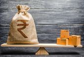 Indian Rupee Inr Symbol Money Bag And A Bunch Of Boxes On Scales. Trade Exchange Balance. Import And poster