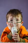 Little Boy In A Mask, Treatments Respiratory Tract With A Nebulizer At Home. Baby Sits With A Nebuli poster