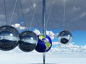 picture of kinetic  - Newtons Cradle Earth - JPG