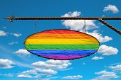 Lgbt Flag On A Signboard. Oval Signboard Colors Lgbt Flag Hanging On A Metal Forged Structure. Templ poster