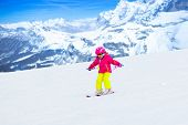 Family Ski And Snow Fun In Winter Mountains poster