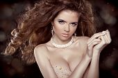 Fashion Sexy Girl Model With Blowing Curly Hair. Jewelry And Beauty Photo, Over Dark
