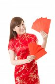 Attractive Chinese woman dress traditional cheongsam and hold red envelope, closeup portrait on whit
