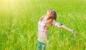 Woman having fun outdoor, enjoying fresh air and spring green grass, freedom and happiness concept