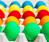 Different colorful Easter eggs, happy holiday, chicken egg, traditional Christian eastertime painted eggs, rainbow colors