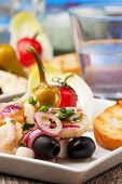 stock photo of ouzo  - closeup of greek salad of grilled octopus - JPG