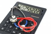 stock photo of diagnostic medical tool  - stethoscope and calculator - JPG