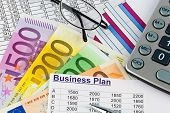 a business plan for starting a business. ideas and strategies for self-employment. euro banknotes an