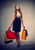 elegant woman with many shopping bags