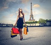 beautiful woman goes shopping in Paris