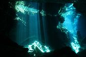 image of playa del carmen  - Sunbeams Breaking Through the Surface in Chac Mool Cenote Playa del Carmen Mexico - JPG