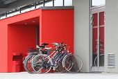 Several old bicycles at door to modern building. Ecology transportation concept.