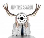 Unsuccessful manager (politician, boss, worker, etc) with shooting target and great antlers. Funny p