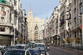 MADRID - MAR 8: Cars at Gran Via street, Mar 8 2012, Madrid, Spain. In late 1930s, modern Gran Via w
