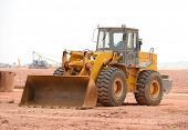 stock photo of bulldozers  - bulldozer on a building site - JPG