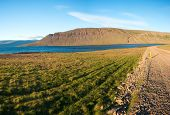 Mighty fjords rise from the sea in the Westfjords Peninsula, northwestern Iceland. Panoramic photo