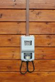 Electricity Supply Meter On Wooden Wall Front View