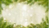 Christmas retro background with christmas tree branches. Raster version of vector.