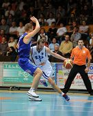 KAPOSVAR, HUNGARY �¢�?�? OCTOBER 26: Hrvoje Puljko (in white) in action at a Hungarian Championship basketball game with Kaposvar (white) vs. Fehervar (blue) on October 26, 2013 in Kaposvar, Hungary.