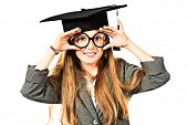 Portrait of a pretty ten years girl in big round spectacles and academic hat. Isolated over white.