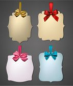 Holiday gift cards with color ribbons and satin bows. Vector illustration.