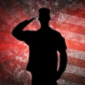 Saluting Soldier's Silhouette On An Army Camouflage Background