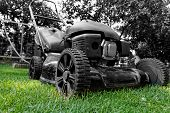 picture of grass-cutter  - Black lawnmower in the garden lawn the grass with fuel engine bw color - JPG