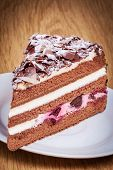 stock photo of black-cherry  - Swiss Black Forest Cherry Cake on the plate - JPG