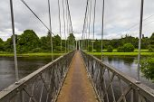 stock photo of brig  - This is the Penny Brig, a footbridge over the river Spey at Aberlour, Speyside, Moray, Scotland, UK.