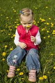 Little Girl Sniffing Dandelion.