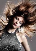 picture of blown-up  - Portrait of beautiful and fashion model woman with blown hairs - JPG