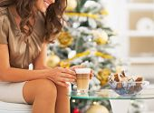 Closeup On Woman Having Latte Macchiato And Candies Near Christm