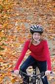 Girl On Fall Bike Path